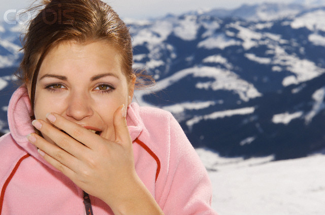 Yawning Young Woman in Mountains