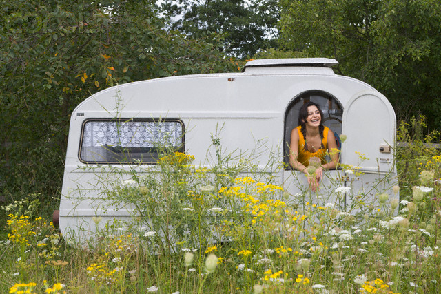 Woman in Caravan in Meadow