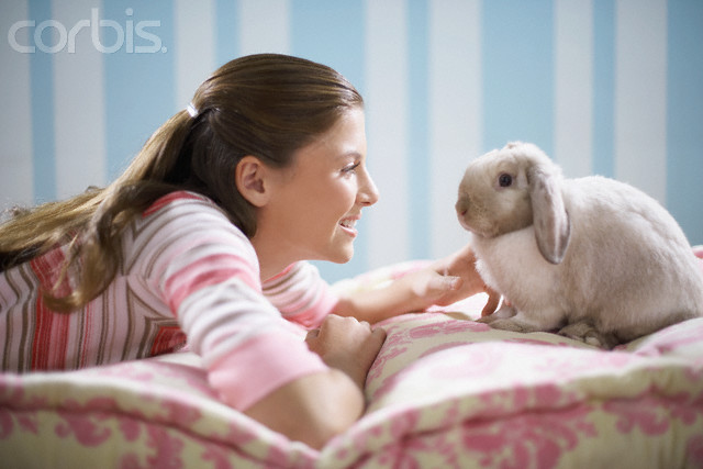 Teenage Girl With Pet Rabbit