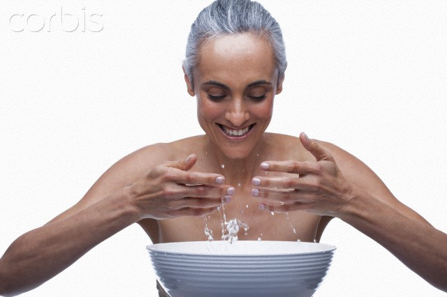 Mature woman washing face