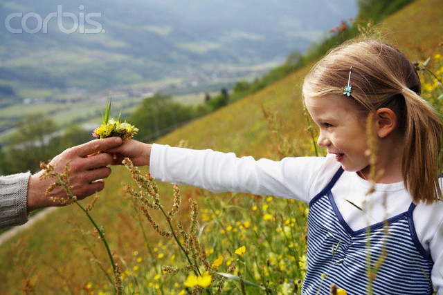 Girl Giving Her Father Some Flowers