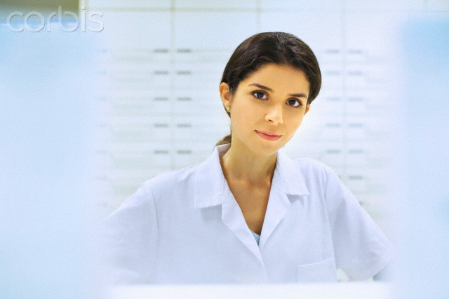 Portrait of young female pharmacist at work