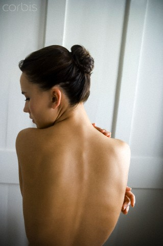 A naked young woman, back view